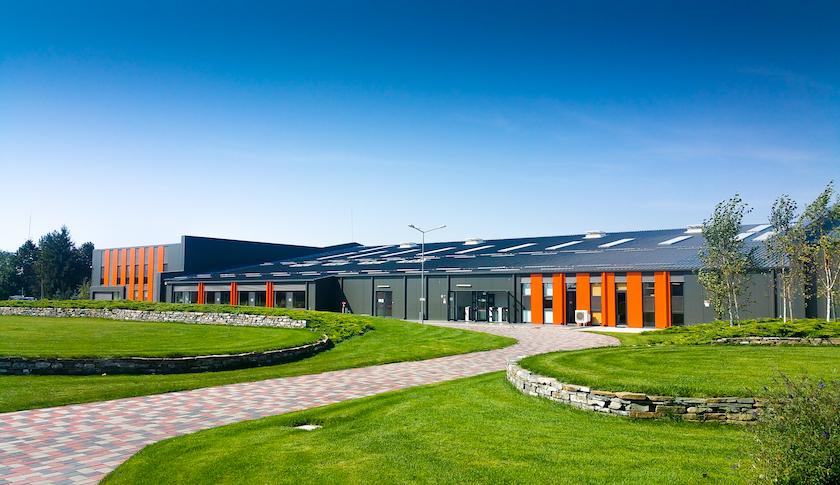 metal hall production grey orange exterior
